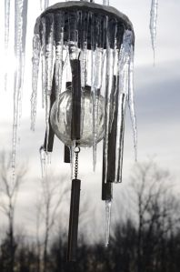 Frozen wind chimes on the porch